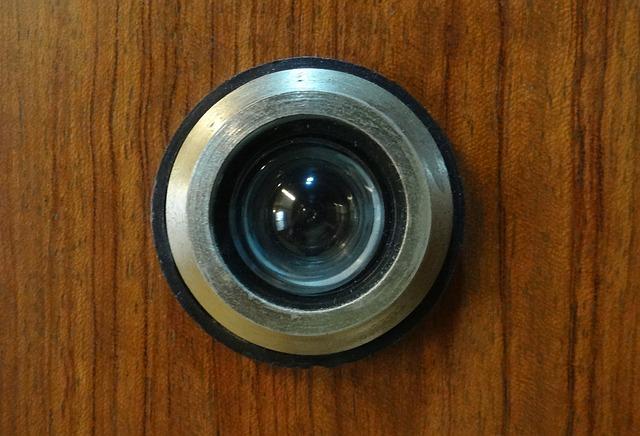 Security peephole in wooden door