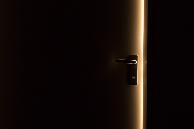 Door opening in dark room