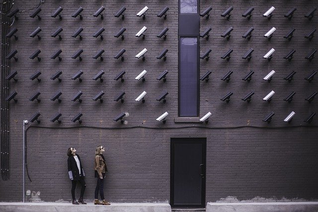 Wall covered in CCTV cameras